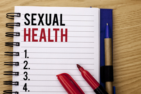 Handwriting text writing Sexual Health. Concept meaning STD prevention Use Protection Healthy Habits Sex Care written Notebook Book the wooden background Marker and Pencil next to it. Stock Photo