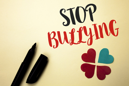 Word writing text Stop Bullying. Business concept for Do not continue Abuse Harassment Aggression Assault Scaring written by Marker the plain background Hearts next to it.