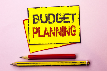 Text sign showing Budget Planning. Conceptual photo Financial Plannification Evaluation of earnings and expenses written Yellow Sticky Note Paper the Pink background with Pencil next to it. Stock Photo