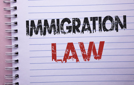 Word writing text Immigration Law. Business concept for National Regulations for immigrants Deportation rules written Notebook Book the plain background. Stok Fotoğraf
