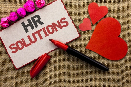 Word writing text Hr Solutions. Business concept for Recruitment Solution Consulting Management Solving Onboarding written Cardboard Piece the jute background Marker and Hearts next to it.