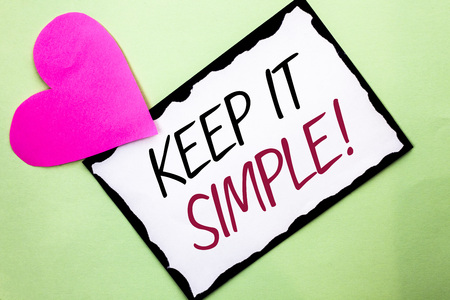 Handwriting text writing Keep It Simple Motivational Call. Concept meaning Simplify Things Easy Clear Concise Ideas written White Sticky Note Paper Plain background with Heart next to it. Stockfoto