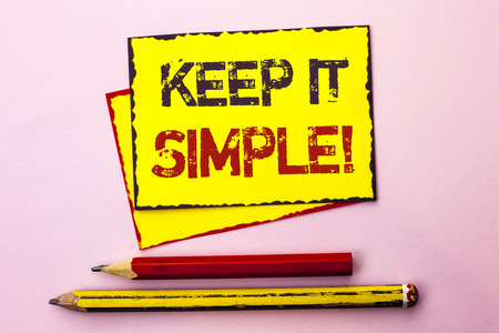 Text sign showing Keep It Simple Motivational Call. Conceptual photo Simplify Things Easy Clear Concise Ideas written Yellow Sticky Note Paper the Pink background with Pencil next to it.