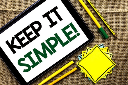 Text sign showing Keep It Simple Motivational Call. Conceptual photo Simplify Things Easy Clear Concise Ideas written Tablet the jute background Pens Pencil and Sticky Note Papers Stock Photo