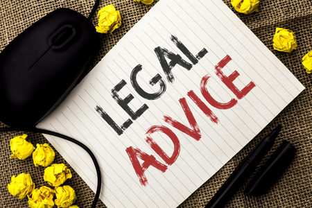 Word writing text Legal Advice. Business concept for Recommendations given by lawyer or law consultant expert written Notebook Paper the jute background Marker and Mouse next to it. Reklamní fotografie