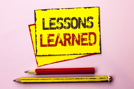 Text sign showing Lessons Learned. Conceptual photo Experiences that should be taken into account in the future written Yellow Sticky Note Paper the Pink background with Pencil next to it.