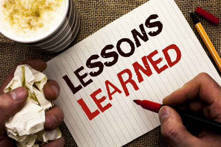 Writing note showing Lessons Learned. Business photo showcasing Experiences that should be taken into account in the future written by Man Holding Marker Notebook Book the jute background