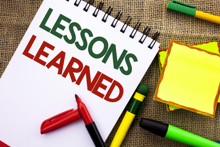 Writing note showing  Lessons Learned. Business photo showcasing Experiences that should be taken into account in the future written Notebook Book the jute background Sticky Note Papers Pens