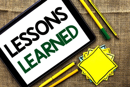 Text sign showing Lessons Learned. Conceptual photo Experiences that should be taken into account in the future written Tablet the jute background Pens Pencil and Sticky Note Papers Banque d'images