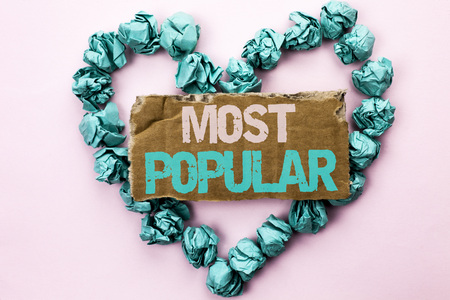 Most Popular. Business photo showcasing Top Rating Bestseller Favorite Product or Artist 1st in ranking written Tear Cardboard Plain background Heart Paper Balls.