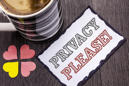 Handwriting text Privacy Please Motivational Call. Concept meaning Let us Be Quiet Rest Relaxed Do not Disturb written Sticky Note Paper the wooden background Coffee Cup and Heart next to it.