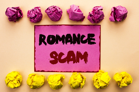 Word writing text Romance Scam. Business concept for Dating Cheat Love Embarrassed Fraud Cyber Couple Affair written Pink Sticky Note Paper the plain background Paper Balls. Stock Photo