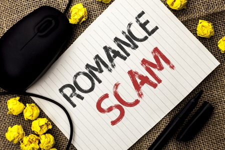 Word writing text Romance Scam. Business concept for Dating Cheat Love Embarrassed Fraud Cyber Couple Affair written Notebook Paper the jute background Marker and Mouse next to it.