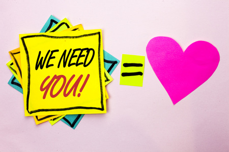Text sign showing We Need You Motivational Call. Conceptual photo Company wants to recruit Employee required written Yellow Sticky Note Paper the plain background Pink Heart next to it. 写真素材