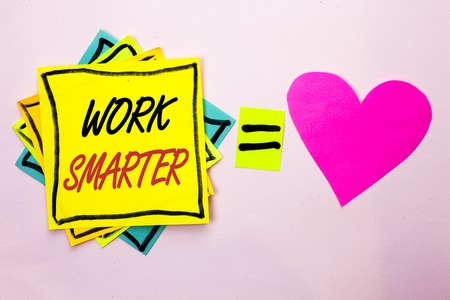 Text sign showing Work Smarter. Conceptual photo Efficient Intelligent Job Task Effective Faster Method written Yellow Sticky Note Paper the plain background Pink Heart next to it.