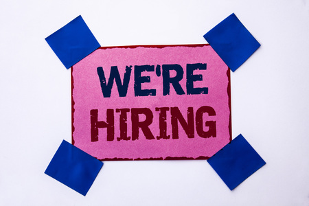 Conceptual hand writing showing Were Hiring. Business photo text Recruiting Hiring Now Recruitment Vacancy Announced Hire written Pink Sticky Note Paper the plain background.