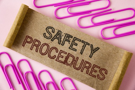 Handwriting text writing Safety Procedures. Concept meaning Follow rules and regulations for workplace security written Folded Cardboard paper piece plain background within Paper Pins. Imagens