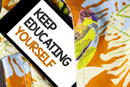Conceptual hand writing showing Keep Education Yourself. Business photo text Learning skills with your own competencies written Mobile Phone Screen the printed fabric background.
