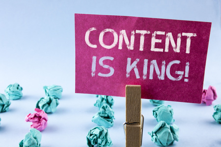 Word writing text Content Is King Motivational Call. Business concept for Strategy online internet digital seo written Pink Sticky Note Paper holding by Clip plain background Paper Balls