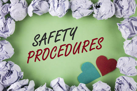 Text sign showing Safety Procedures. Conceptual photo Follow rules and regulations for workplace security written plain green background within White Paper Balls Hearts next to it. Imagens