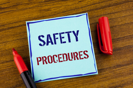 Word writing text Safety Procedures. Business concept for Follow rules and regulations for workplace security written Sticky note paper the Wooden background Marker next to it. Imagens