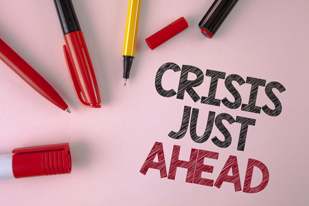 Conceptual hand writing showing Crisis Just Ahead. Business photo text Foresee failure take right action before it is late written plain Pink background Pens and Marker next to it.