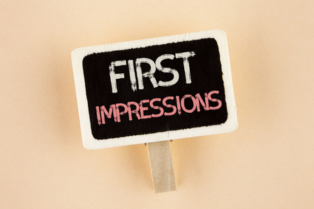 Handwriting text First Impressions. Concept meaning Encounter presentation performance job interview courtship written Wooden Notice Board the plain background. Imagens
