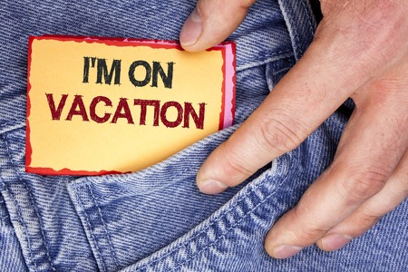 Word writing text I Am im On Vacation. Business concept for Break from stressful work pressure travel worldwide written Sticky Note Paper holding by man the Jeans background. Stockfoto - 99356423