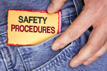 Word writing text Safety Procedures. Business concept for Follow rules and regulations for workplace security written Sticky Note Paper holding by man the Jeans background. Imagens