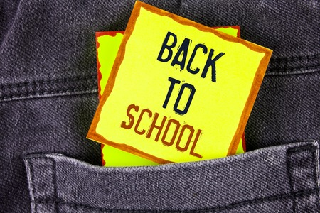 Text sign showing Back To School. Conceptual photo Right time to purchase schoolbag, pen, book, stationary written Yellow Sticky Note Paper placed the Jeans background.