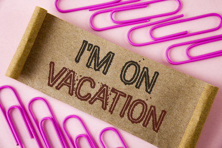 Handwriting text writing I Am im On Vacation. Concept meaning Break from stressful work pressure travel worldwide written Folded Cardboard paper piece plain background within Paper Pins. Stock Photo