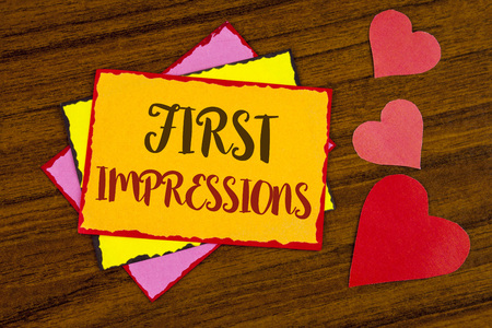 Text sign showing First Impressions. Conceptual photo Encounter presentation performance job interview courtship written Sticky note paper wooden background Hearts next to it.