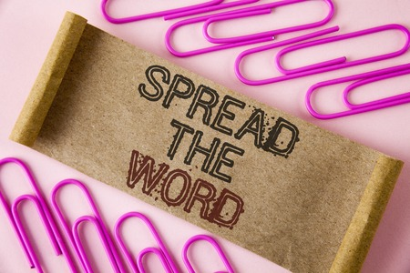 Handwriting text writing Spread The Word. Concept meaning Run advertisements to increase store sales many fold written Folded Cardboard paper piece plain background within Paper Pins.