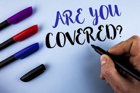 Conceptual hand writing showing Are You Covered Question. Business photo text Health insurance coverage disaster recovery written by Man plain background Markers next to it.