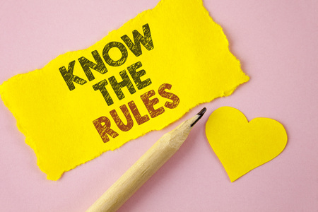 Writing note showing  Know The Rules. Business photo showcasing Understand terms and conditions get legal advice from lawyers written Tear Yellow paper piece Pink background Heart next to it. Stock Photo