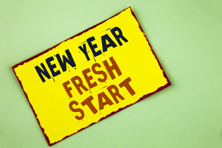 Writing note showing  New Year Fresh Start. Business photo showcasing Time to follow resolutions reach out dream job written Yellow Colored Sticky note paper plain background. Archivio Fotografico