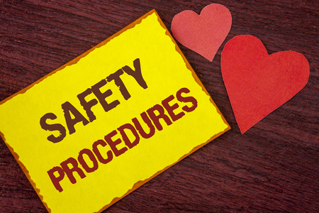Conceptual hand writing showing Safety Procedures. Business photo text Follow rules and regulations for workplace security written Yellow Sticky note paper wooden background Hearts.  Imagens