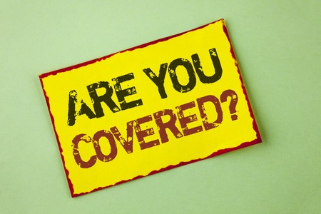Word writing text Are You Covered Question. Business concept for Health insurance coverage disaster recovery written Yellow Sticky Note Paper the plain background.