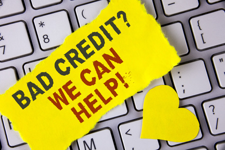 Word writing text Bad Credit Question We Can Help Motivational Call. Business concept for achieve good debt health written tear Sticky Note Paper placed the Laptop Yellow Heart next to it. 写真素材