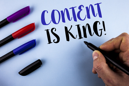 Conceptual hand writing showing Content Is King Motivational Call. Business photo text Strategy online internet digital seo written by Man plain background Markers next to it.