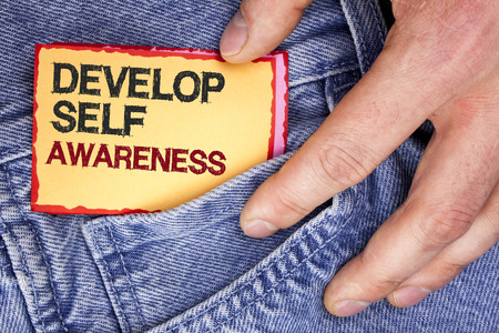 Word writing text Develop Self Awareness. Business concept for What you think you become motivate and grow written Sticky Note Paper holding by man the Jeans background. Archivio Fotografico