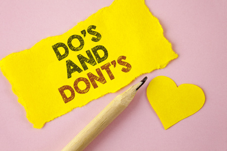 Writing note showing  DoS And DonTs. Business photo showcasing What can be done and what cannot be knowing right wrong written Tear Yellow paper piece Pink background Heart next to it.