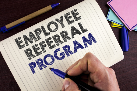Conceptual hand writing showing Employee Referral Program. Business photo showcasing Recommend right jobseeker share vacant job post written by Man Notebook Book wooden background Pen.