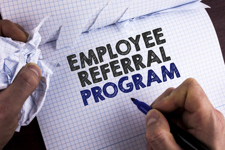 Word writing text Employee Referral Program. Business concept for Recommend right jobseeker share vacant job post written by Man Tear Nootbook Book holding Marker wooden background.