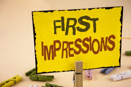 Handwriting text writing First Impressions. Concept meaning Encounter presentation performance job interview courtship written Yellow Sticky Note Paper the plain background Wooden Clips. Imagens
