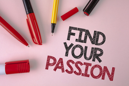 Conceptual hand writing showing Find Your Passion. Business photo text No more unemployment find challenging dream career written plain Pink background Pens and Marker next to it.