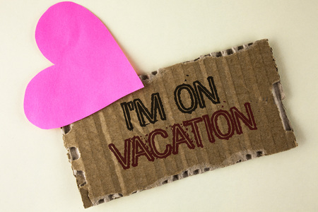 Handwriting text I Am im On Vacation. Concept meaning Break from stressful work pressure travel worldwide written Tear Cardboard Piece on the plain background Heart next to it. Stockfoto