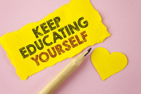 Writing note showing  Keep Education Yourself. Business photo showcasing Learning skills with your own competencies written Tear Yellow paper piece Pink background Heart next to it.