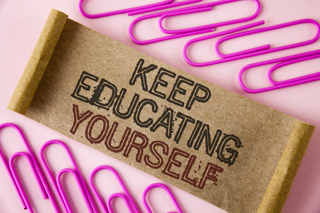 Handwriting text writing Keep Education Yourself. Concept meaning Learning skills with your own competencies written Folded Cardboard paper piece plain background within Paper Pins. Stock Photo