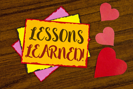 Text sign showing Lessons Learned Motivational Call. Conceptual photo Academic student development optimization written Sticky note paper wooden background Hearts next to it.